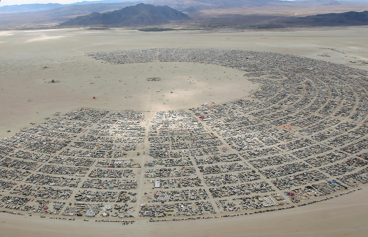An aerial view as approximately 70,000 people from all over the world gather for the 30th annual Burning Man arts and music festival in the Black Rock Desert of Nevada, U.S.